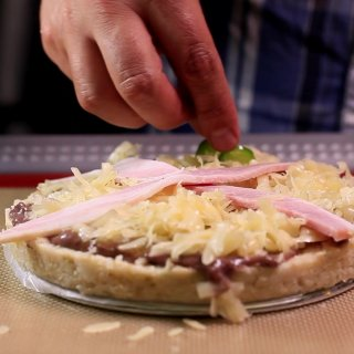 Place sliced chili peppersHow to make a Tamale Pizza