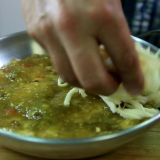 Add sauce and cheeseHow to make a Tamal Gratin